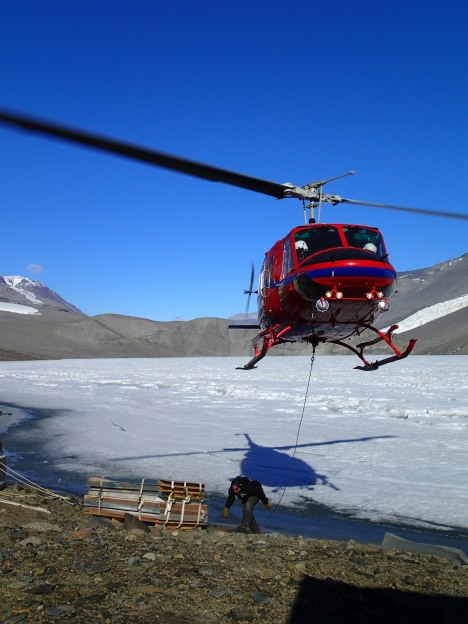 Helo picking up sling load from the Dry Valleys.