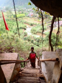Climbing down from Hospital Cave in Cat Ba, Vietnam.
