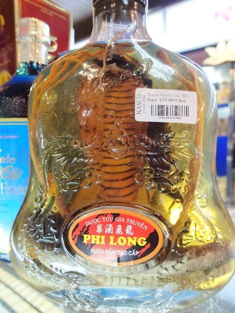 Vietnam. Cobra inside a bottle of liquor.
