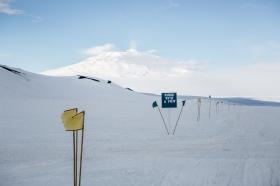 Trail flags and Mt. Erebus. Photo credit: Lena Stevens