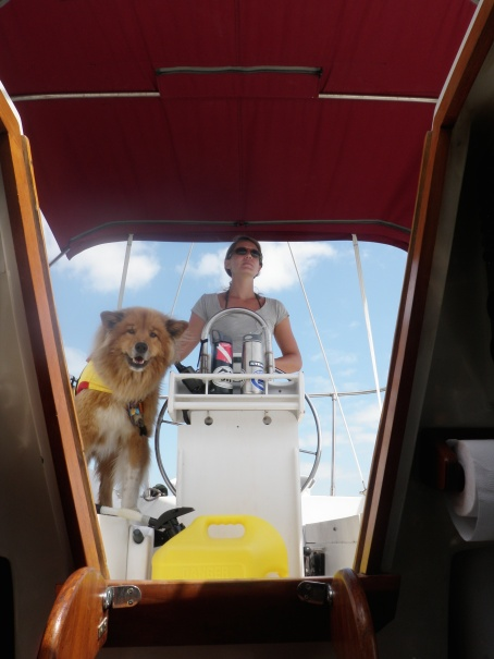 Janae and the dog at the helm.